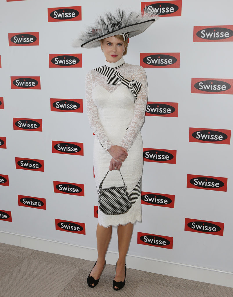 Nicole Kidman in a lacy L'Wren Scott dress  and wide-brimmed Stephen Jones hat.