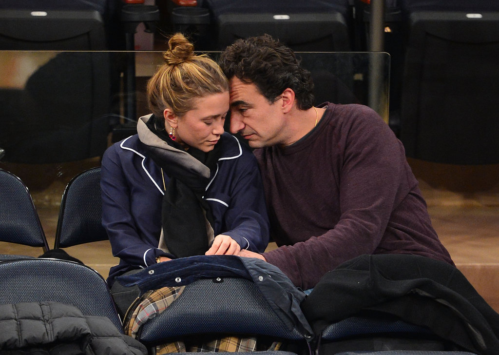 Mary-Kate Olsen and Olivier Sarkozy cuddled up together in the stands.