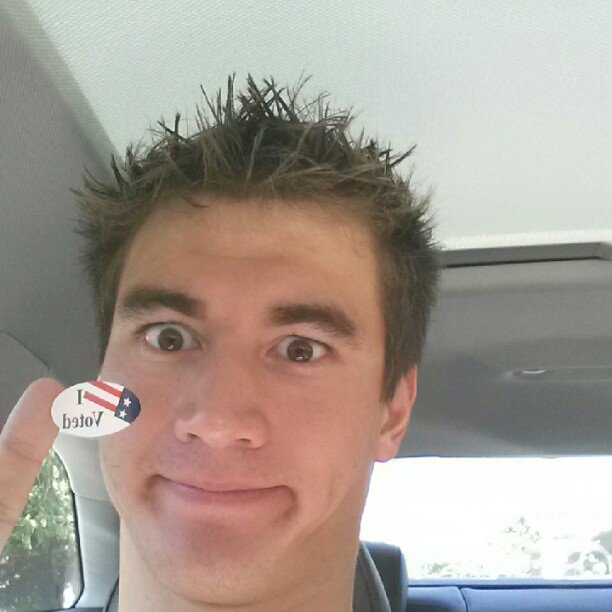 Olympic swimmer Nathan Adrian made a silly face as he showed off his voter's sticker. Source: Instagram user nathangadrian