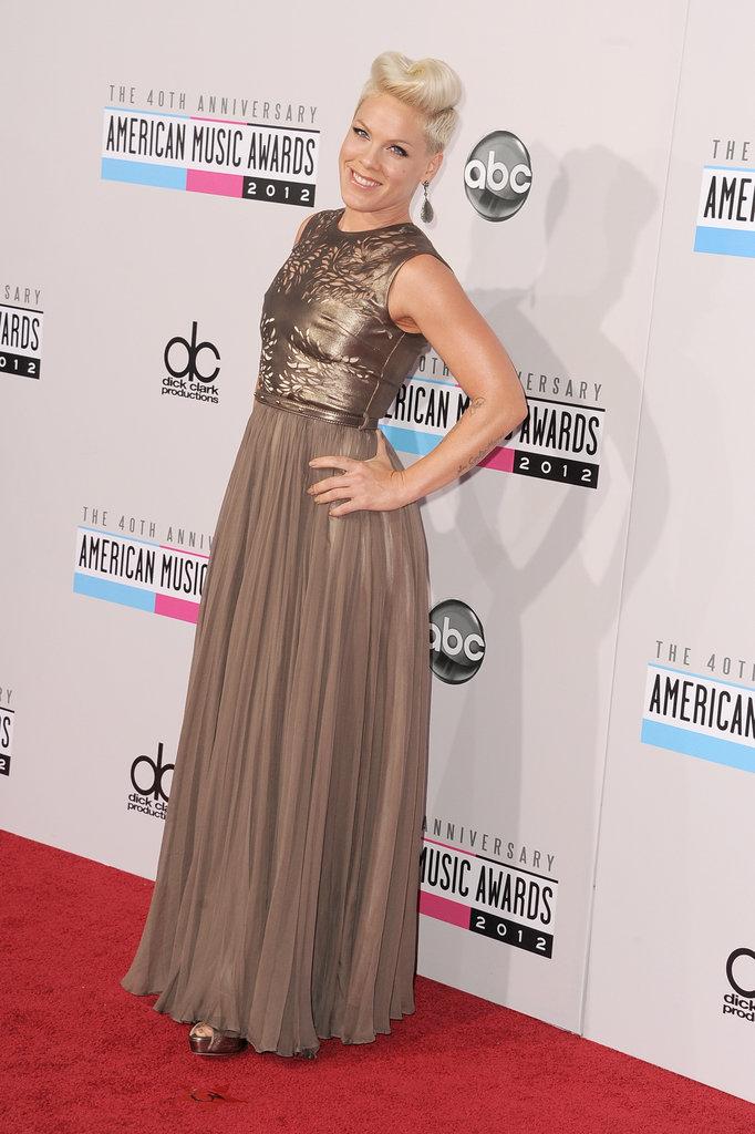 Pink wore a bronze dress.