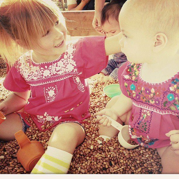 Tori Spelling captured her daughters playing together in a modified sandbox. Source: Instagram user torianddean