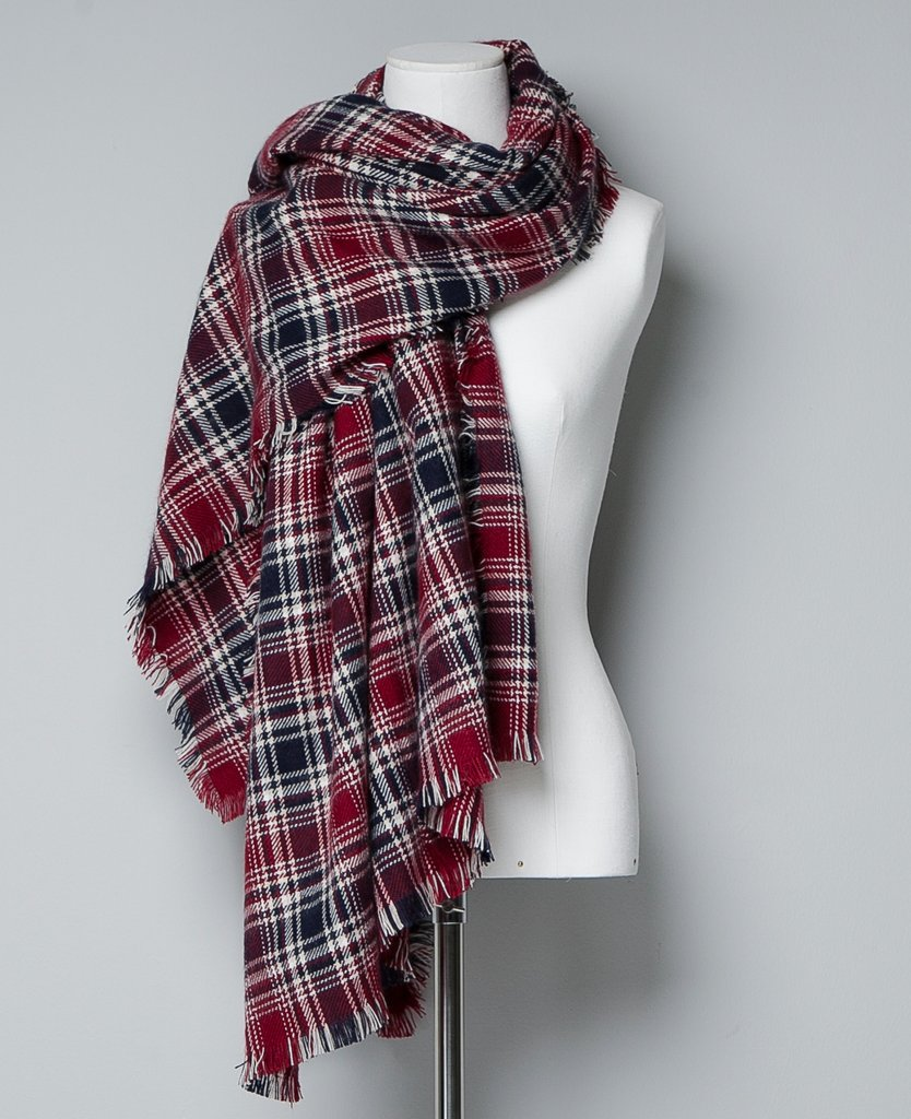 """Have a preppier friend in your life? This Zara checked scarf ($50) is classic, but the frayed hem has a bit of an edge to it. A great example of the """"best of both worlds,"""" in our opinion."""