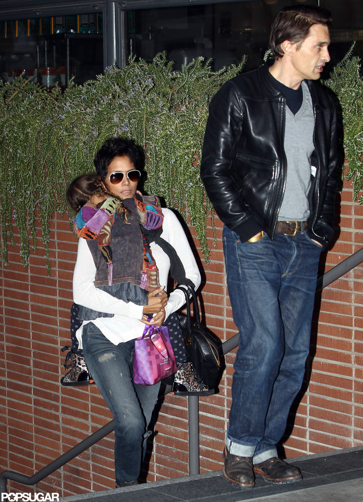 Halle Berry carried Nahla Aubry as she followed Olivier Martinez into an LA movie theater.