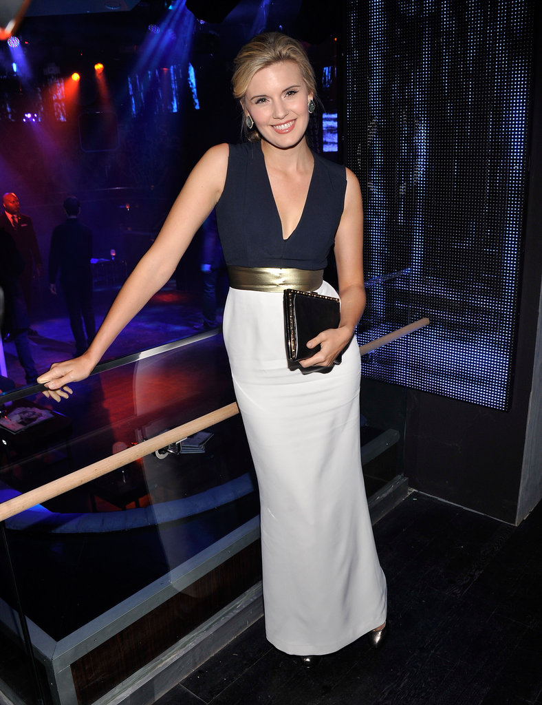 Maggie Grace celebrated with the Twilight crew in a two-tone, navy and white gown cinched with a gold waistband.