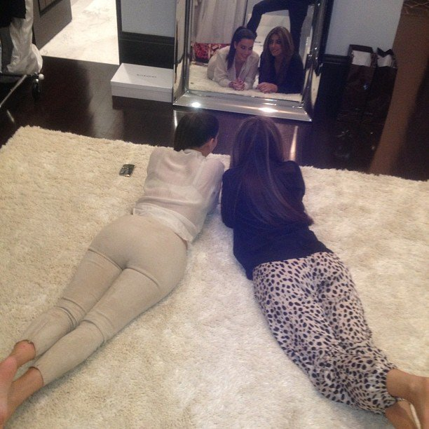 Kim Kardashian and a friend looked cute in neutrals as they posed in the mirror. Source: Instagram user kimkardashian