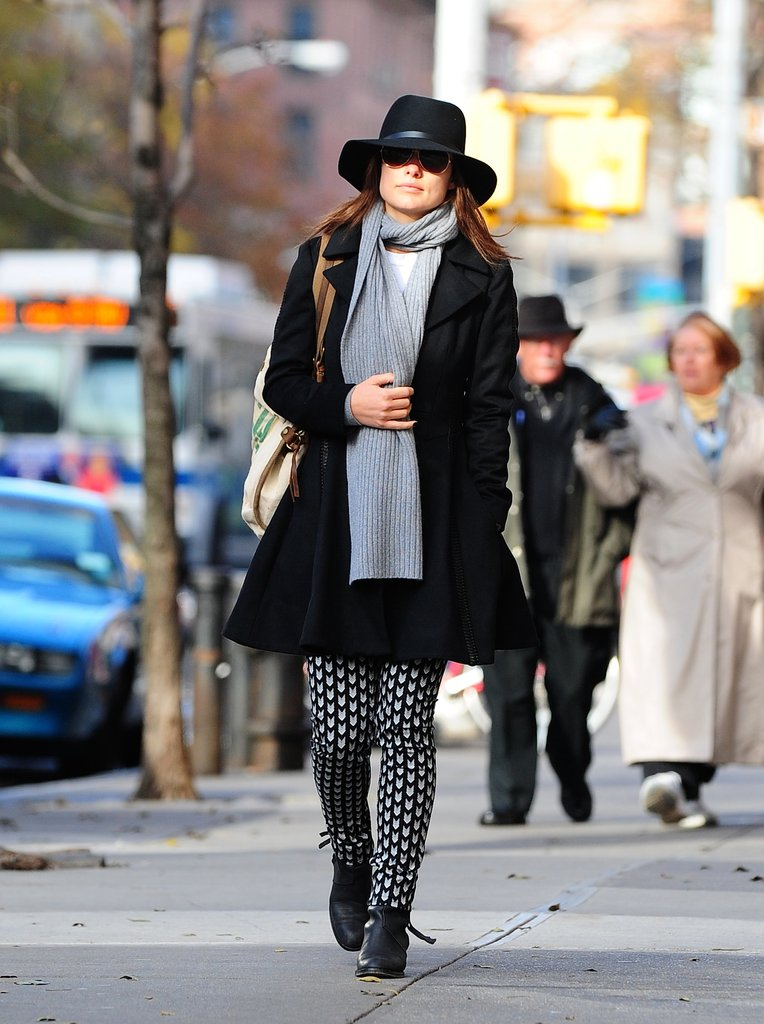 Olivia bundled up in a flared black peacoat, light blue cardigan, and arrow-print Rag & Bone trousers ($495). She topped off her street-chic style with the same scarf and sunnies, then tossed on this Rag & Bone fedora ($175) to up the cool factor. 9140654