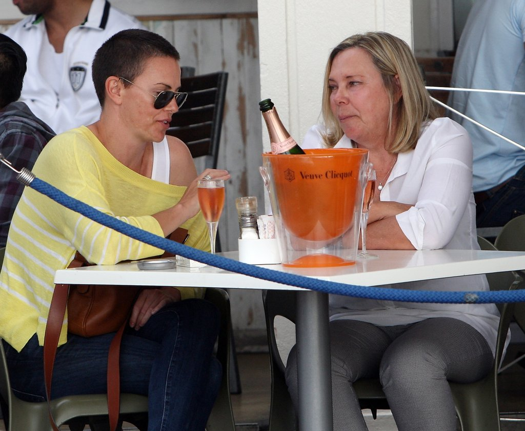 Charlize Theron and her mom, Gerda, chatted over Champagne.