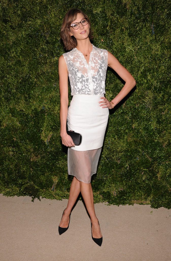 We love how Karlie Kloss layered her sheer white lace top with a hint of something darker underneath. It's an evening-appropriate lesson in layering.