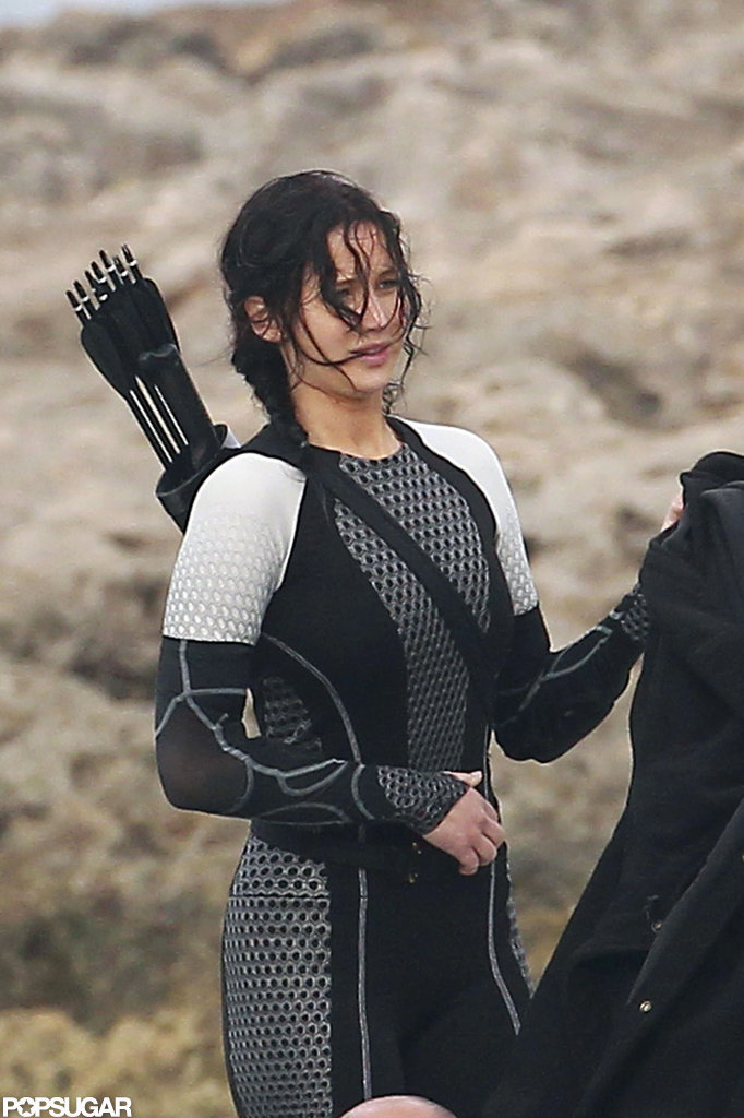 Jennifer Lawrence had a bow and arrow on her back to film scenes for Catching Fire.