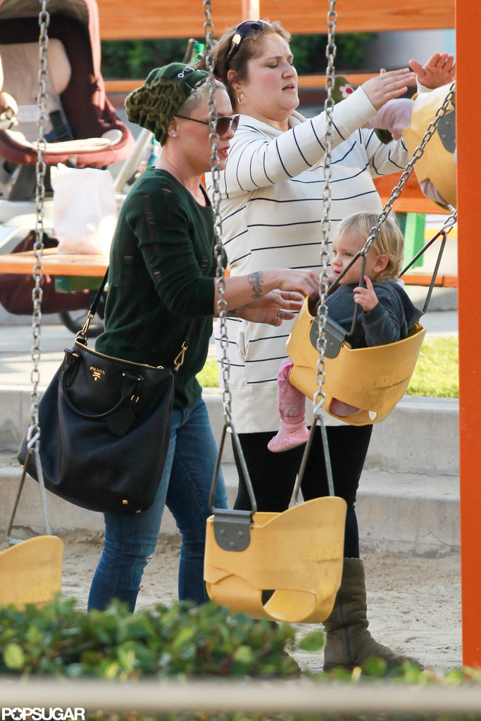 Pink gave Willow Hart a push on the swing.