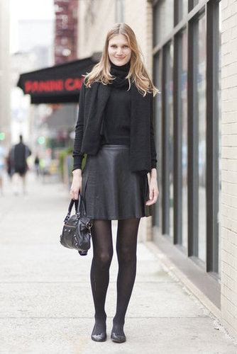 All black gets a more feminine twist with a flared, full skirt and flats. Source: Adam Katz Sinding