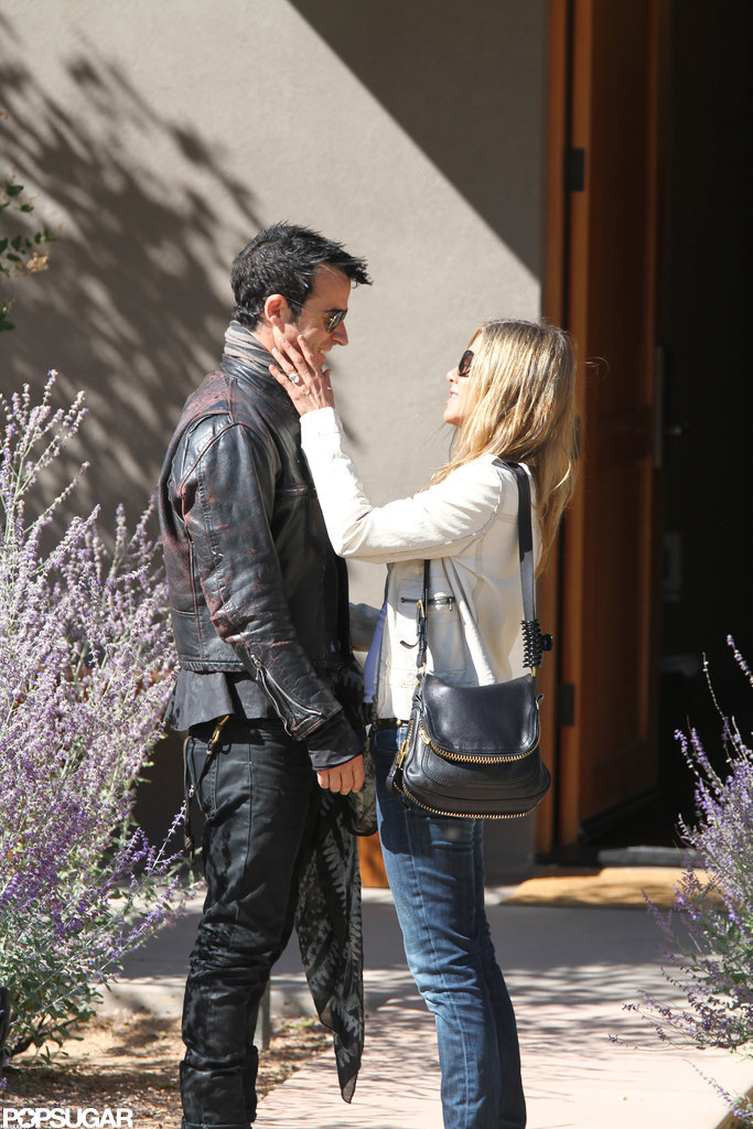 Jennifer Aniston flashed her engagement ring while out in Santa Fe with fiancé Justin Theroux in October.