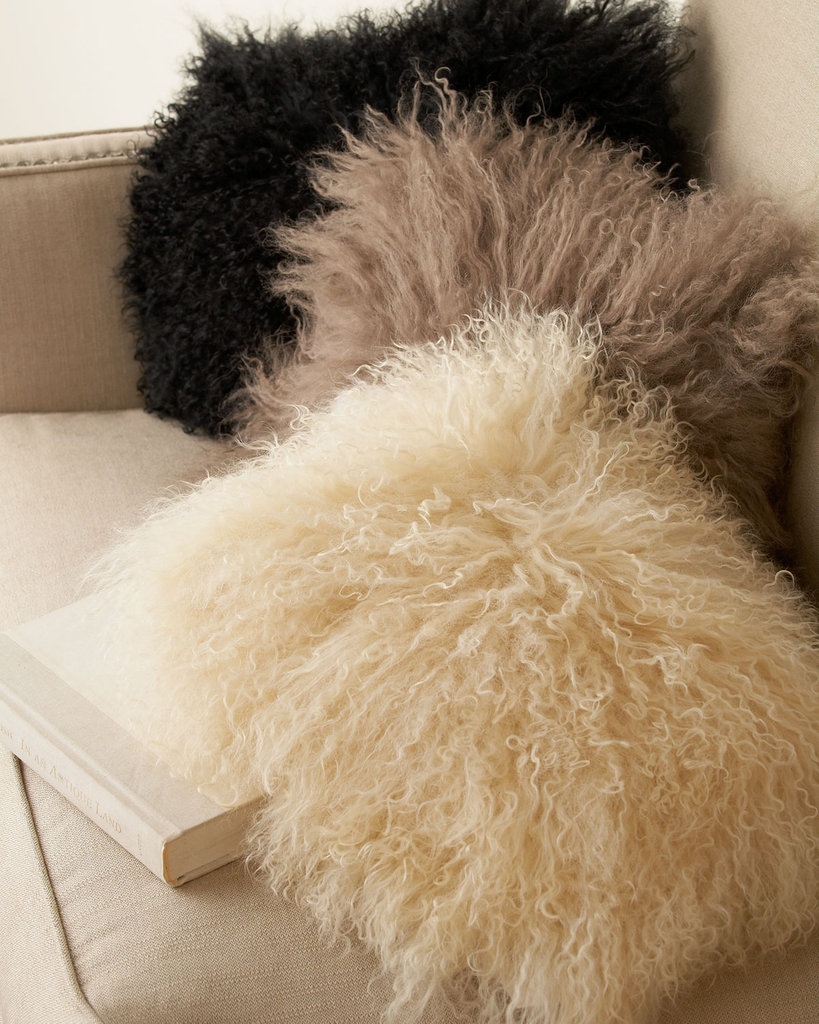 It'll take a little convincing, but if I can get my guy on board, I'm hoping to add these Adrienne Landau Mongolian Pillows ($170 each) to give our sectional a little more personality — Santa, are you listening? — Hannah Weil, associate editor