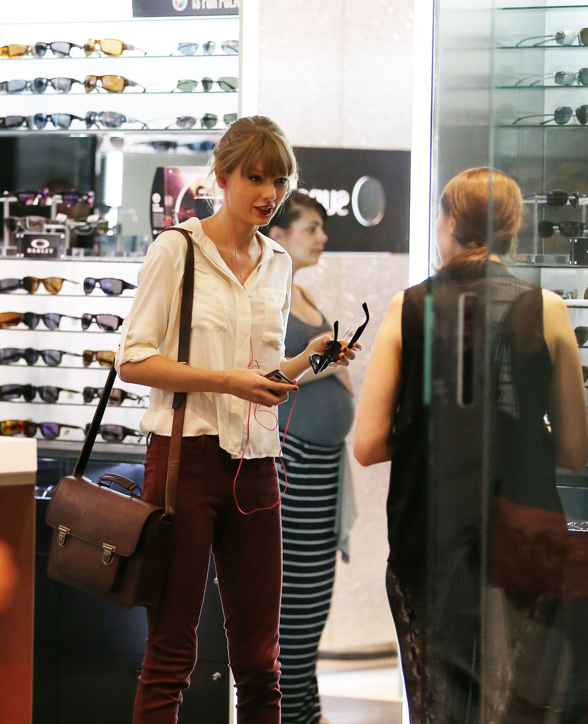 Taylor tried on some shades at Sunglass Hut.