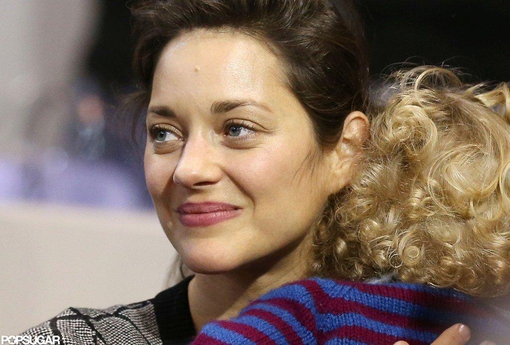 Marion Cotillard held her son, Marcel Canet, close.