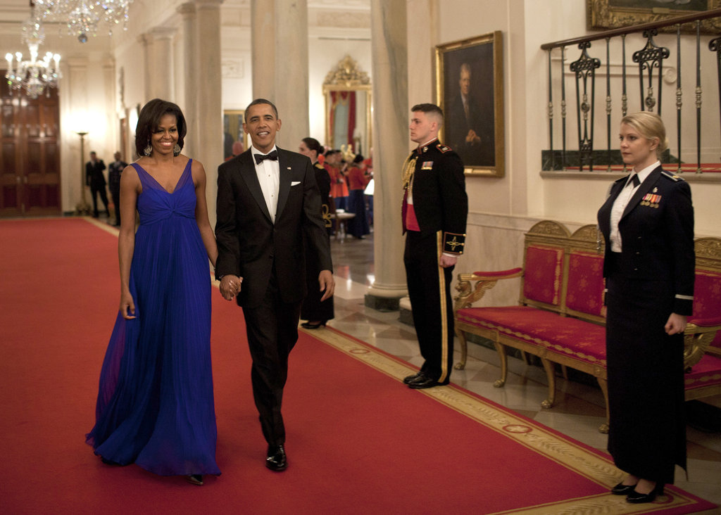 The Obamas held hands before a military dinner in Washington DC.