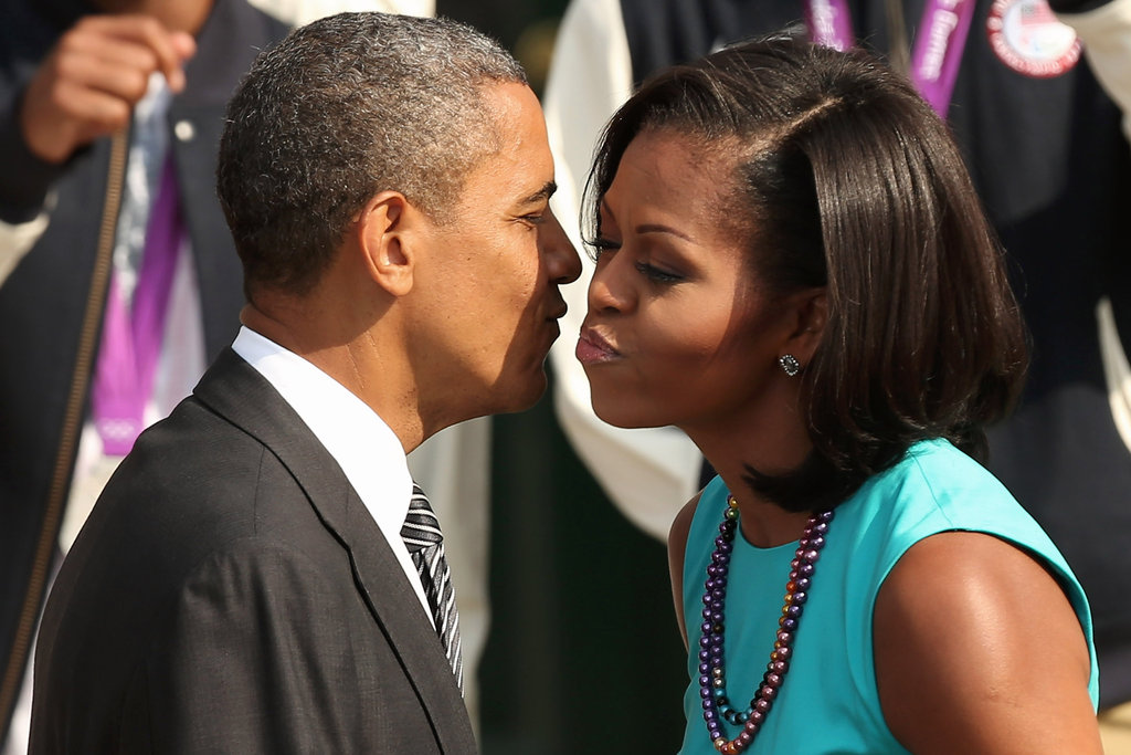 The president and first lady went in for a kiss as they welcomed Olympians to the White House in September.