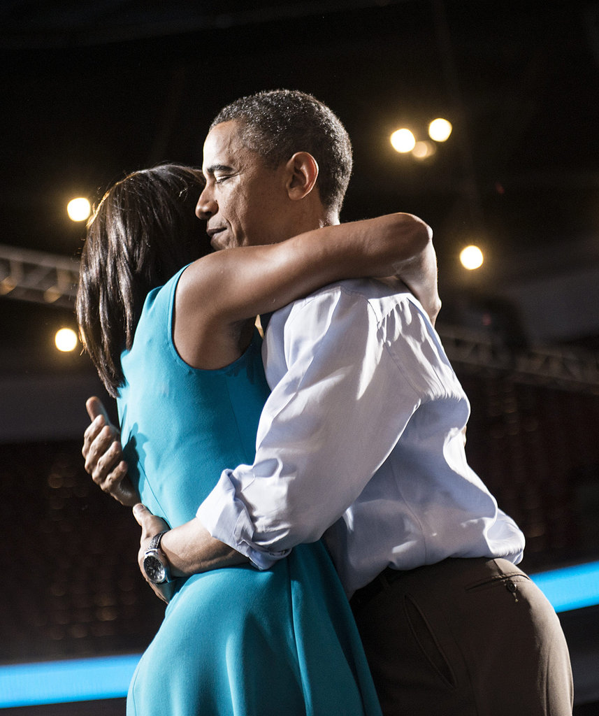 Barack looked thoughtful as he hugged Michelle at an Ohio campaign event.