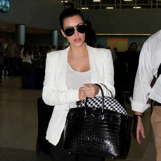 Kim Kardashian Carrying Black Crocodile Bag