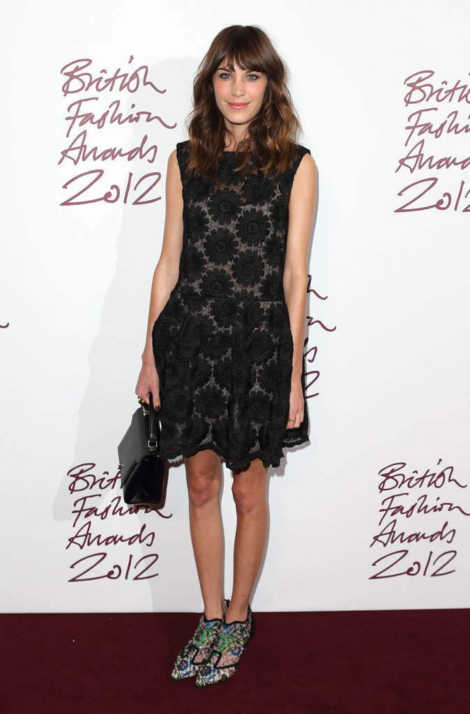 Alexa Chung kept it sweet in a Simone Rocha dress but went a little more fashion-forward with her footwear. Take note: this is an easy styling trick to employ for your own holiday party look.