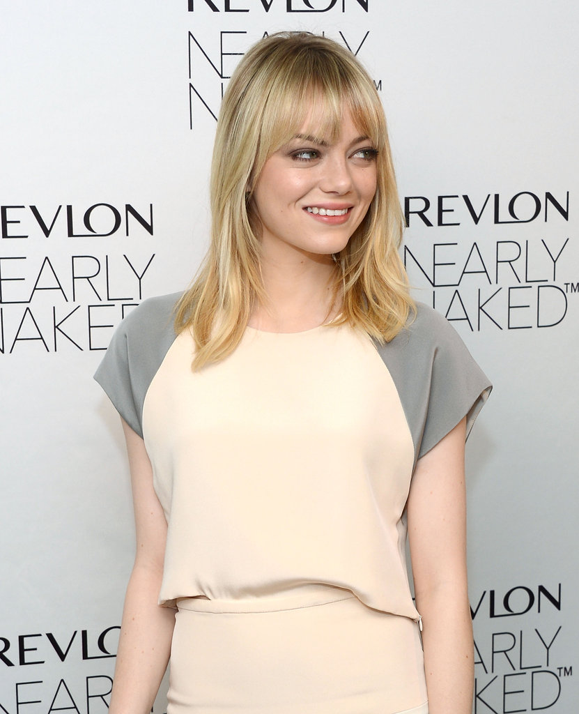 Emma Stone smiled at Revlon's makeup launch in NYC.