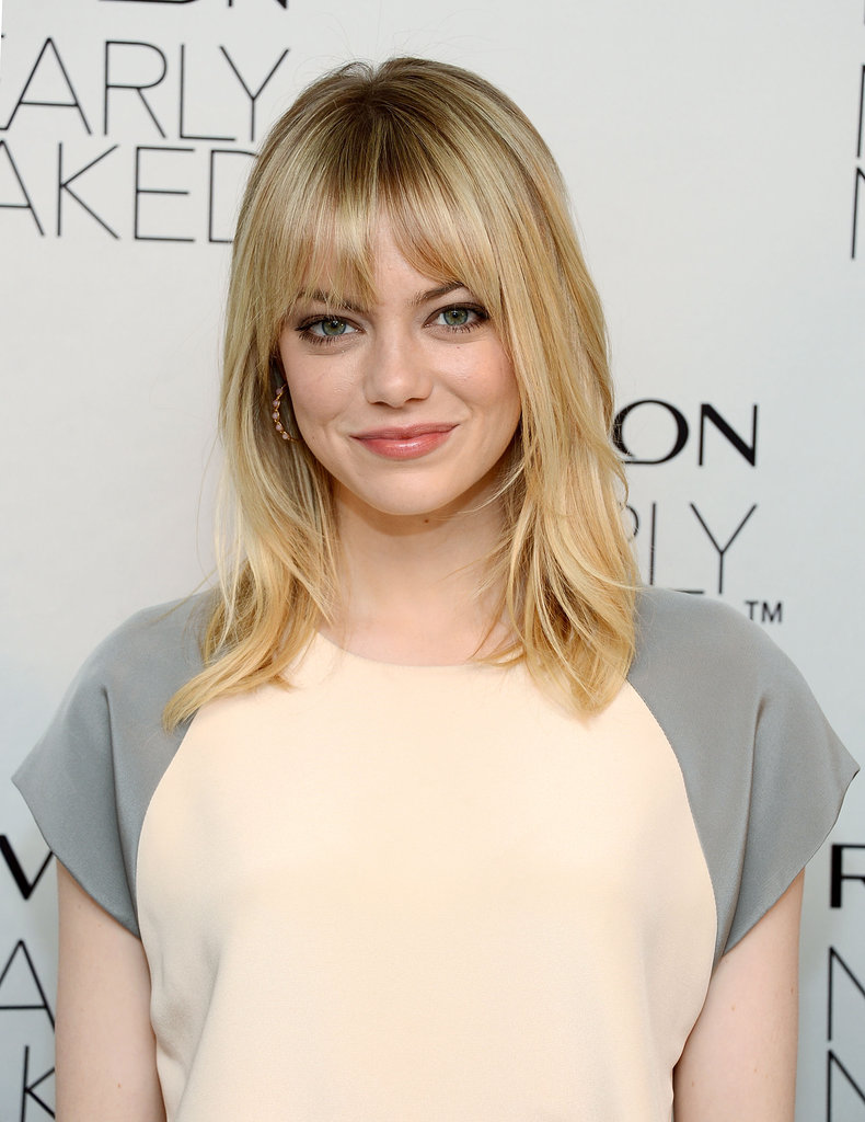 Emma Stone smiled at the Revlon makeup launch in NYC.