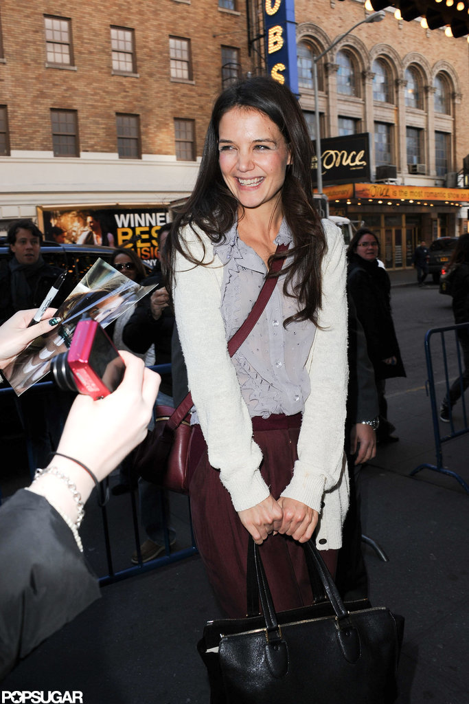 Katie Holmes smiled at fans outside the theater.