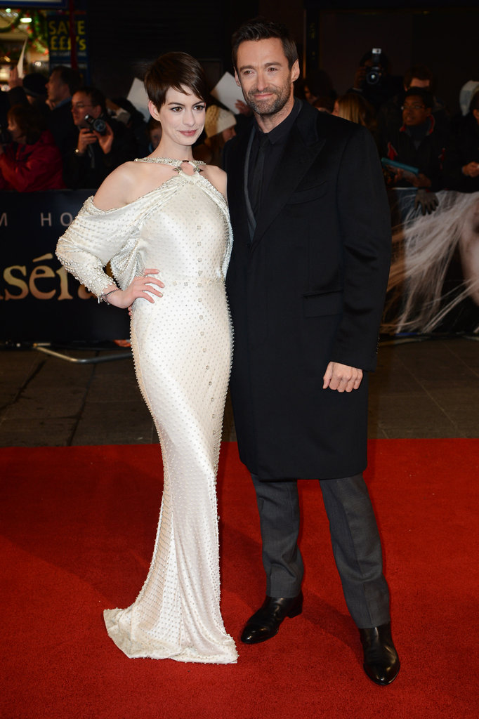 One last shot of Anne and her Les Misérables co-star Hugh Grant on the red carpet. What do you think of her premiere look? Tell us in the comments below!