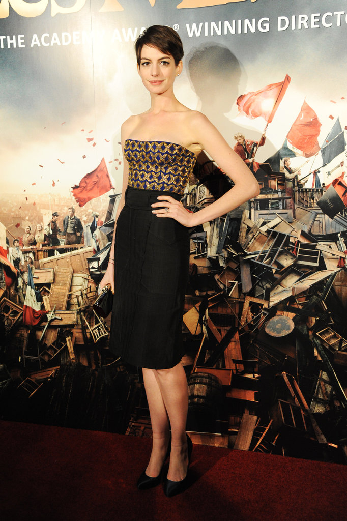 Anne Hathaway changed into a strapless dress for the Les Mis afterparty.