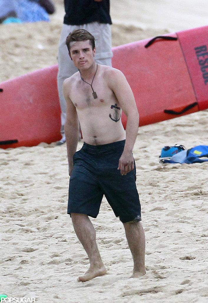 Josh Hutcherson walked on the beach.
