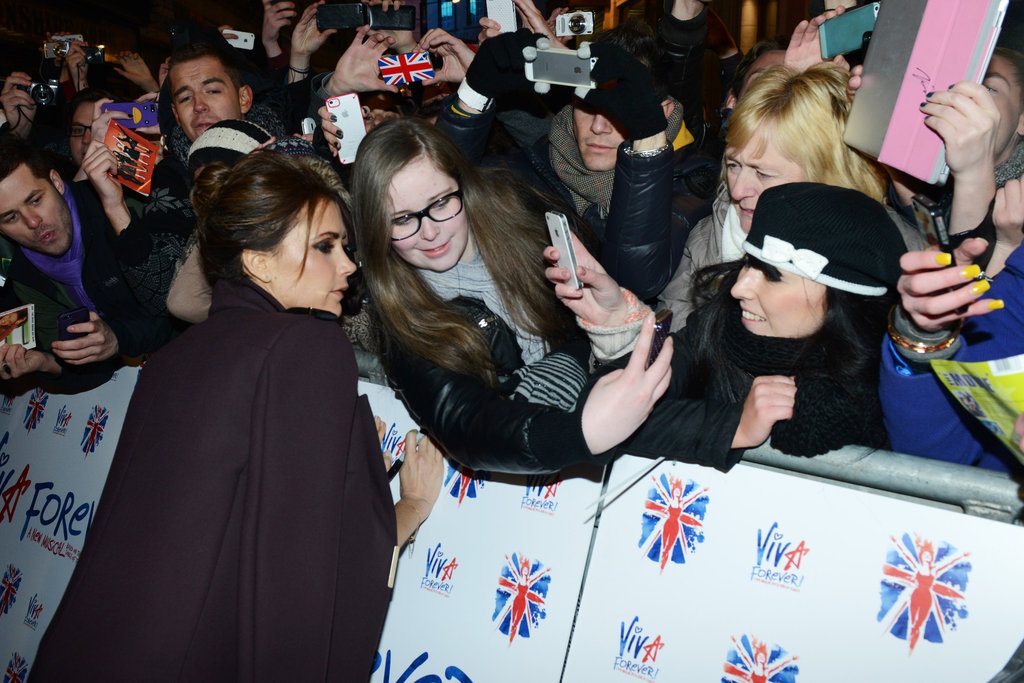 Victoria Beckham hung out with fans in London.