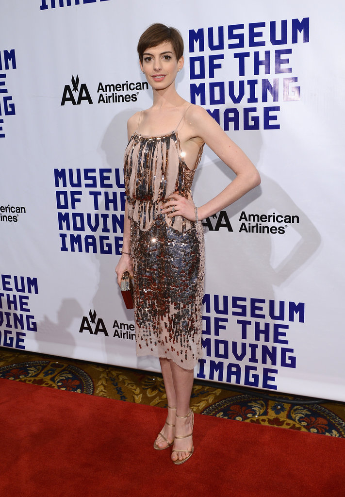 Anne Hathaway's slinky sequined Nina Ricci dress was a stand-out, and works perfectly for a holiday party with friends.