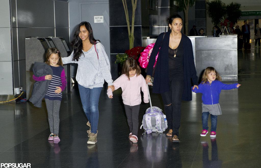 Luciana Damon walked through JFK with Isabella Damon, Alexia Barroso, Gia Damon, and Stella Damon.