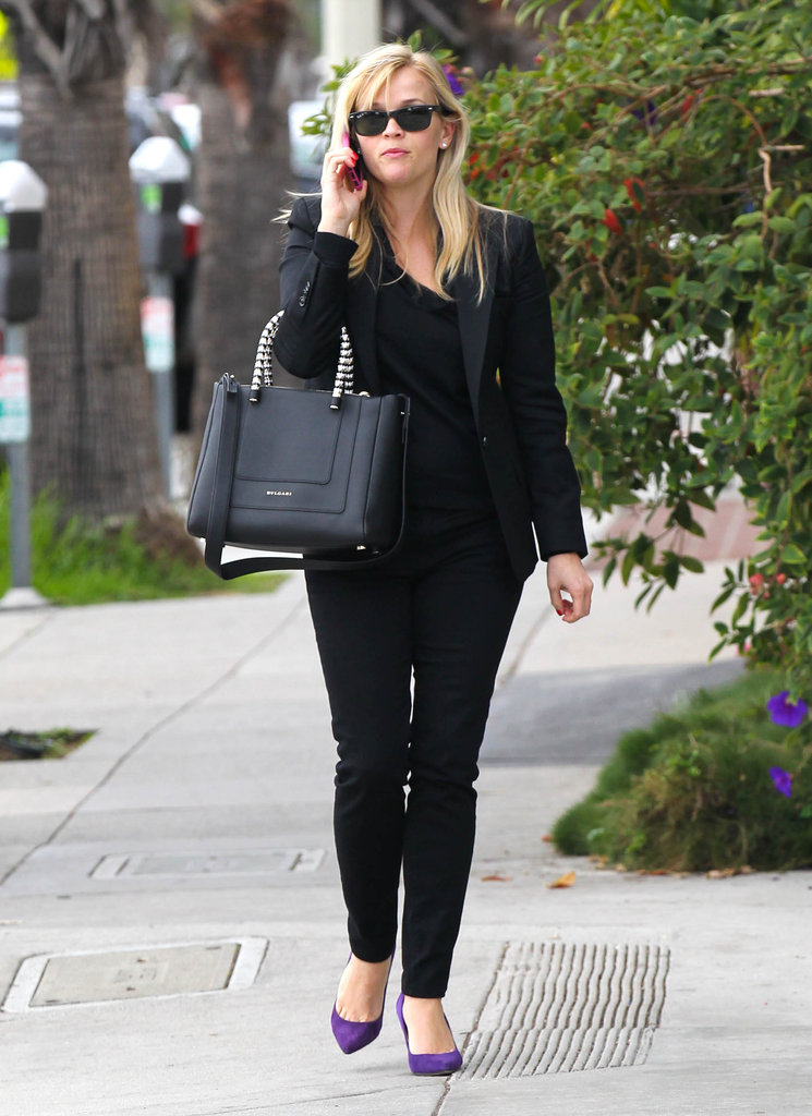 Reese Witherspoon carried a black handbag while she chatted on her cell phone.