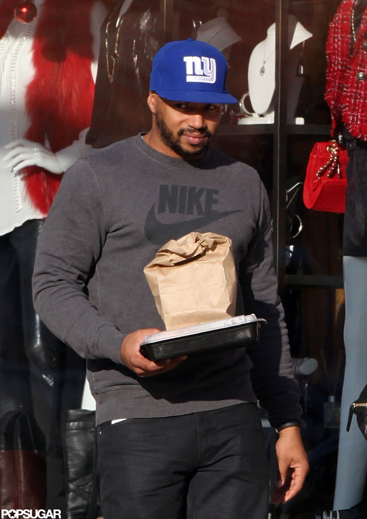 Donald Faison dressed casual in a Nike t-shirt for their Sunday outing.