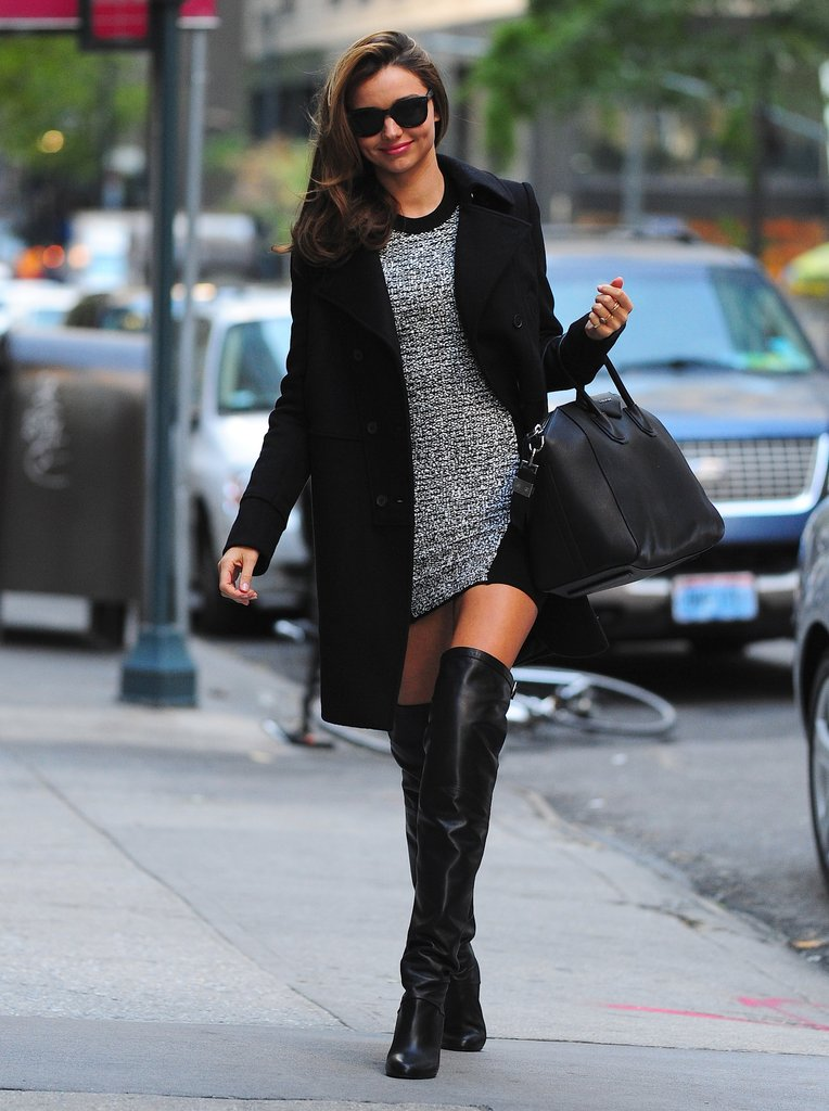 Miranda hit the New York streets before the Victoria's Secret Fashion Show wearing a body-conscious Alexander Wang knit dress under a Givenchy black coat (to match her Antigona tote, no doubt) with show-stopping, knee-high Hermès black boots to highlight her gorgeous legs.
