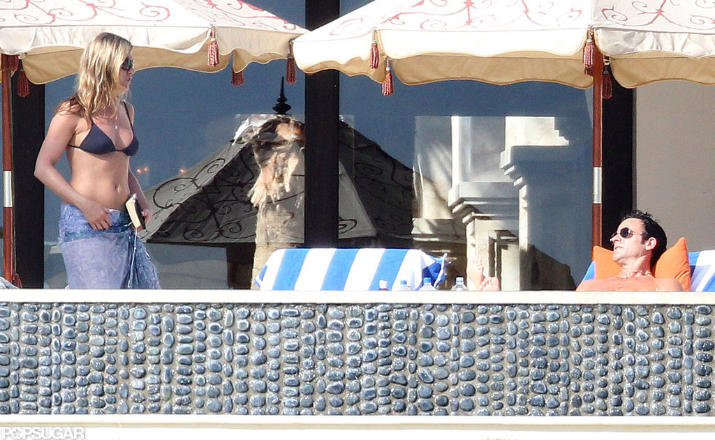 Jennifer Aniston Kisses Justin Poolside During a Bikini Filled NYE