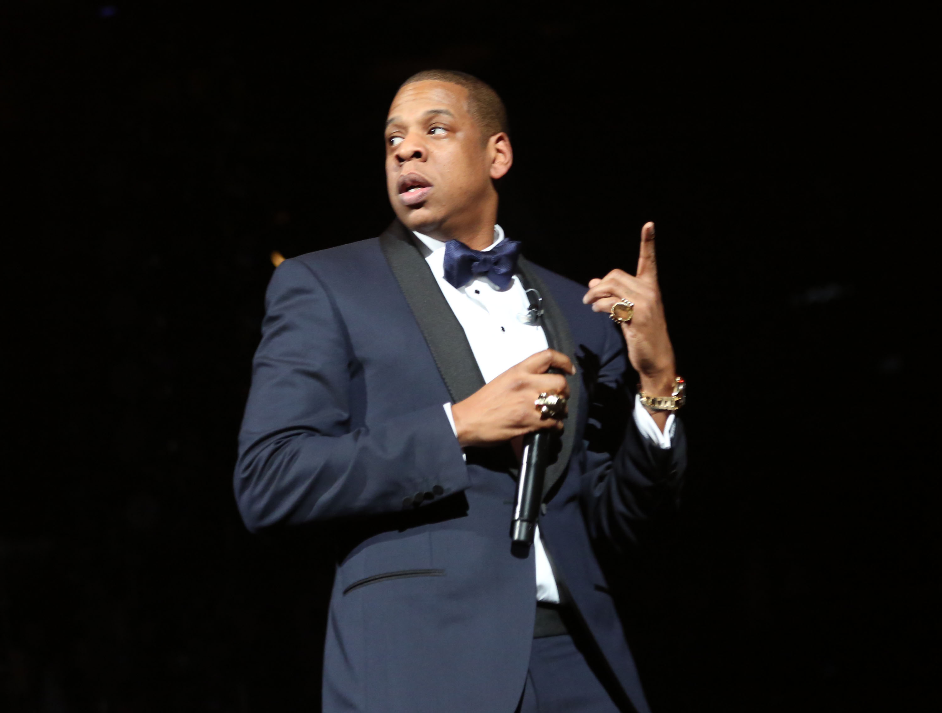 Jay-Z wore a blue and black tux.