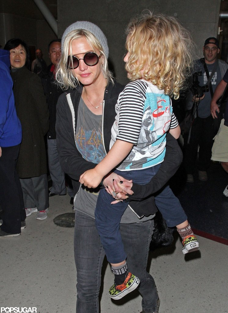 Ashlee Simpson wore sunglasses and a beanie.