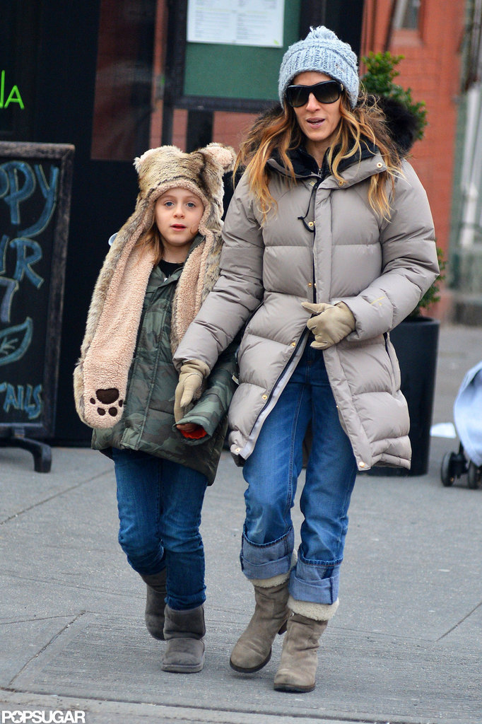 Sarah Jessica Parker wore a puffy jacket to take James Wilkie Broderick for a walk in NYC.