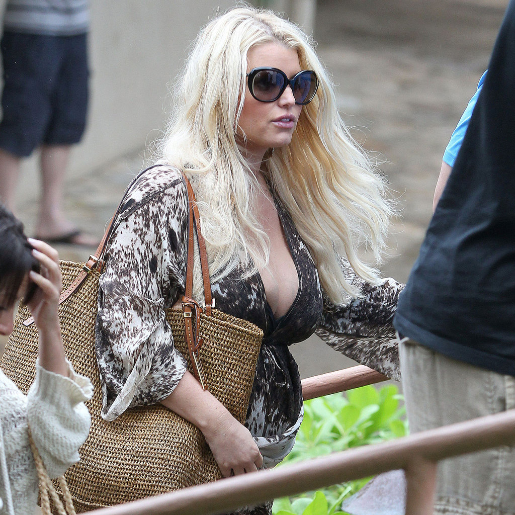 Jessica Simpson showed off her pregnant stomach in a caftan.