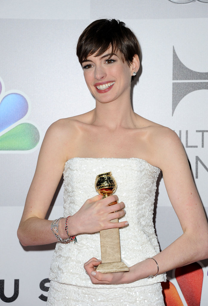 Anne Hathaway wore a white strapless dress.
