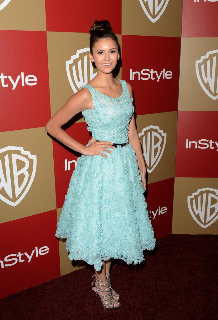 Nina Dobrev wore a light blue dress.