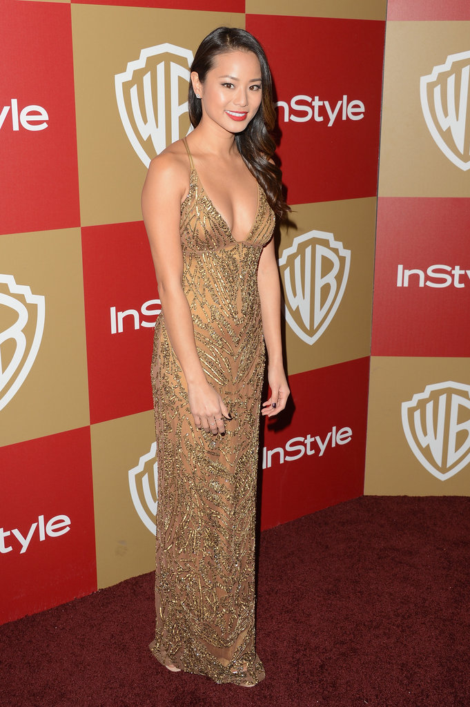 Jamie Chung took her InStyle party look in a very sexy direction, donning a gold-sequin slipdress with a whole lot of decolletage on display.