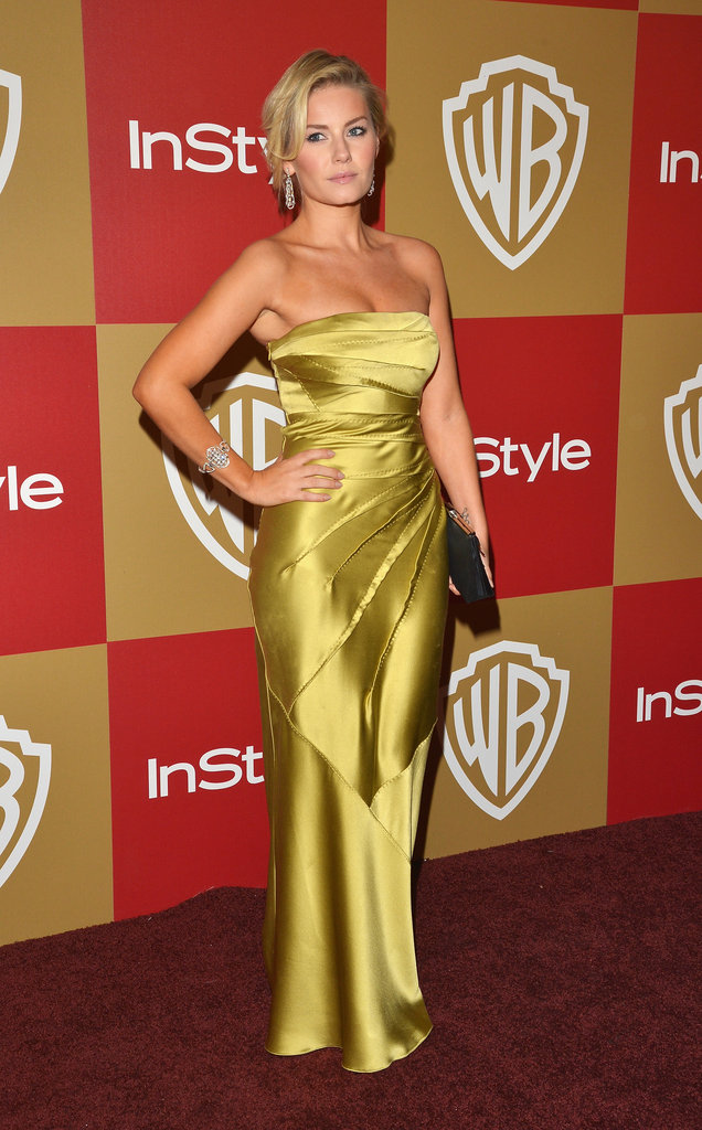 Elisha Cuthbert gravitated toward a brighter kind of evening glamour, showing up to the InStyle party in a silky chartreuse-hued gown.