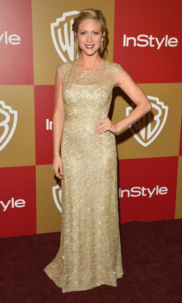 Brittany Snow sparkled in a gold-embellished David Meister Signature gown, and we're particularly loving the sheer-infused neckline.