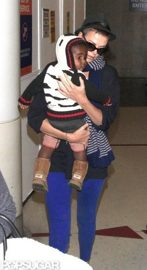 Charlize Theron carried Jackson Theron through the terminal.
