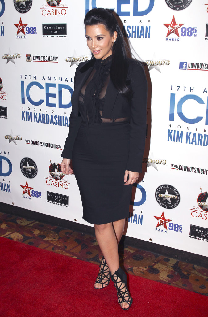 Strappy heels, pencil skirt and sheer blouse — Kim could've stolen this look from Carine Roitfeld.