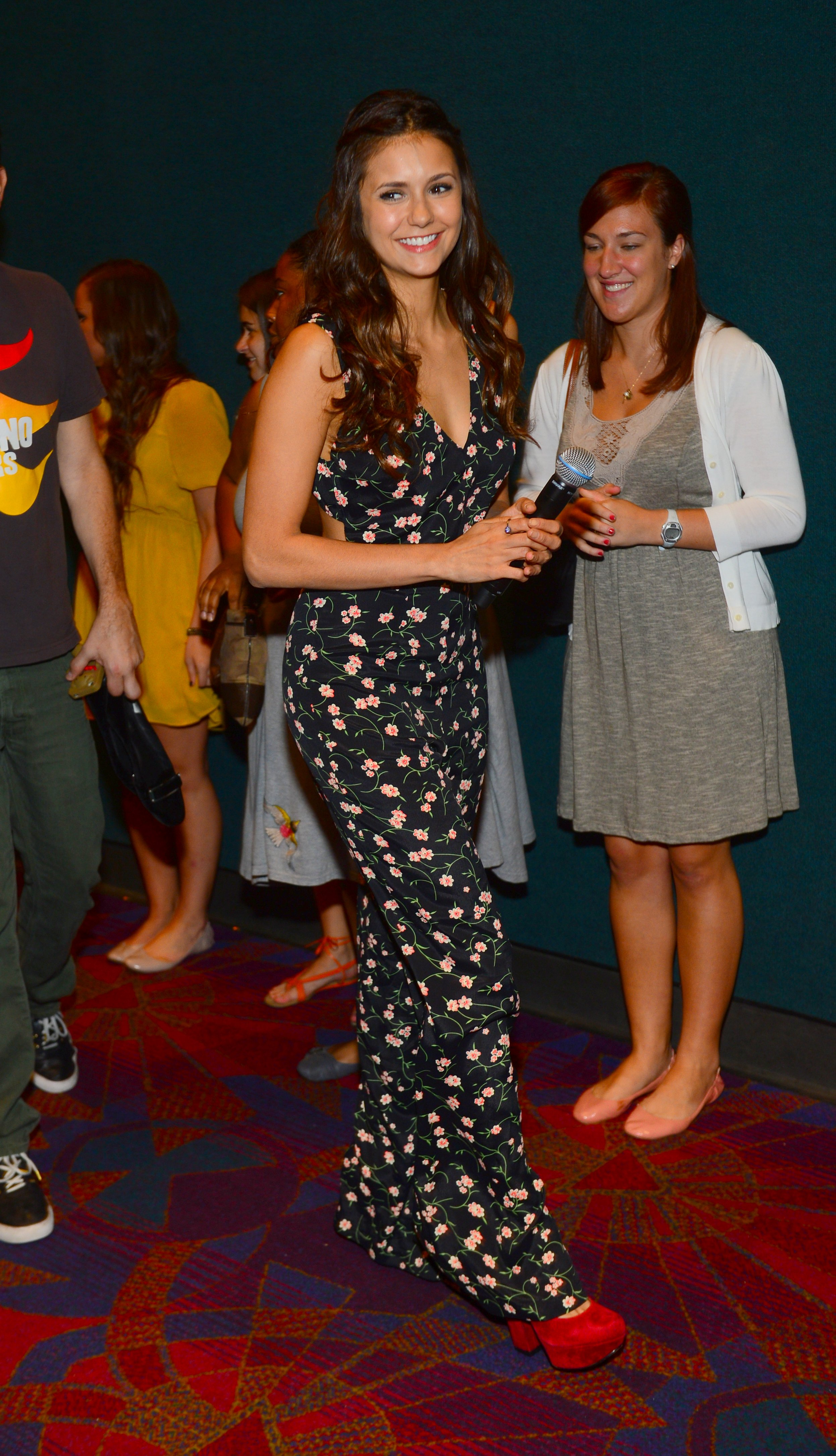 She chose a sweet floral-print jumpsuit — with just a hint of a chunky red platform peeking out — for the Atlanta screening of The Perks of Being a Wallflower.