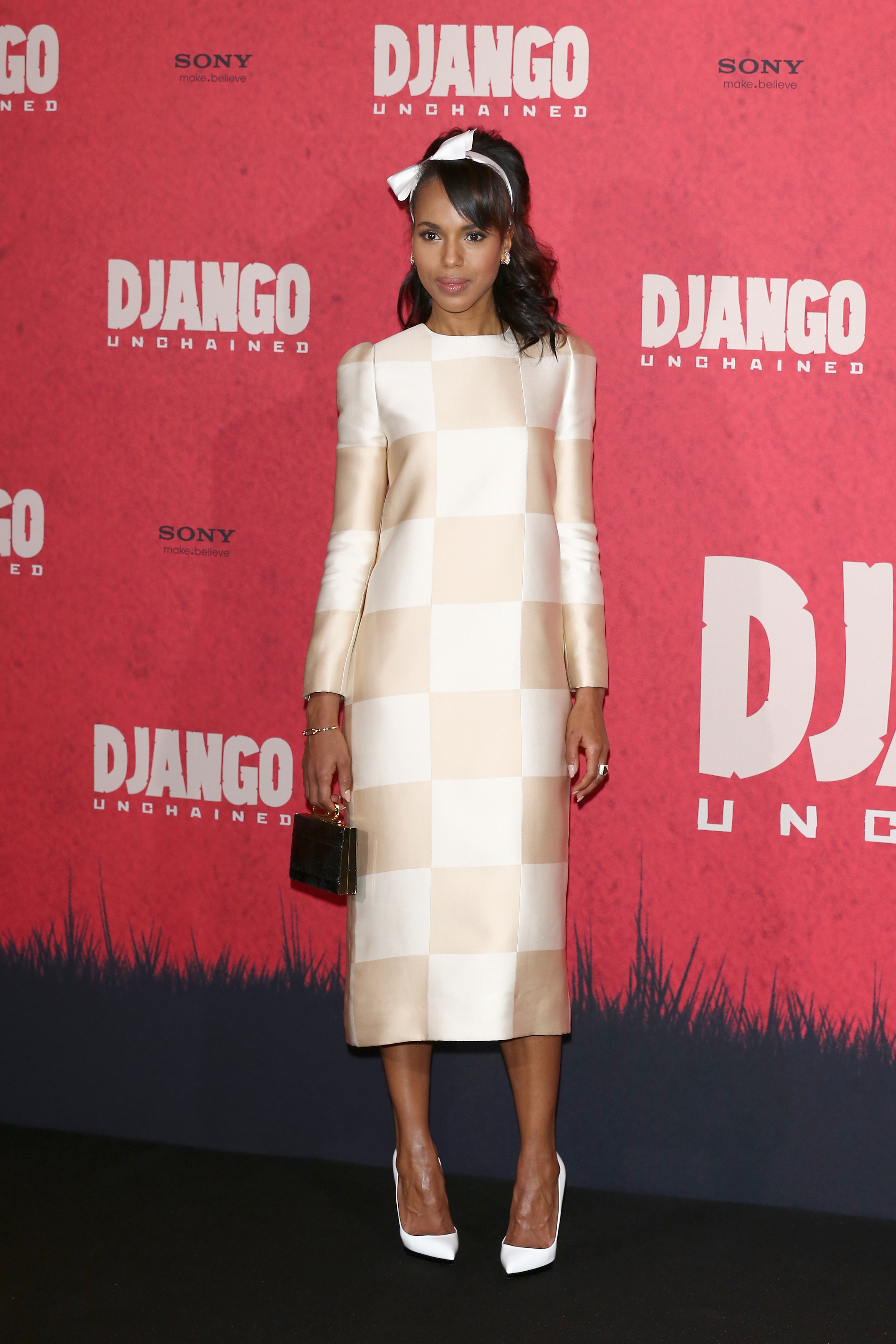 Kerry went for a seriously girlie '60s-inspired look for the movie's photocall in Berlin, wearing a white and cream long-sleeved checkerboard print dress (and dainty bow headband) from Louis Vuitton's Spring 2013 ready-to-wear collection. We can't even digest how cute this look is — while it's certainly a risky one, we think Kerry pulled it off flawlessly. She finished the look with Christian Louboutin's Pigalle Plato pumps and a VC Signature Ring Clutch ($250).